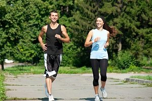 Fitness couple jogging in park